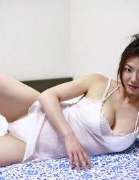 Flirtatious asian idol soaping up her curvy big breasted body