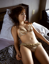 Gorgeous gravure idol with soft plump boobs in a red bikini
