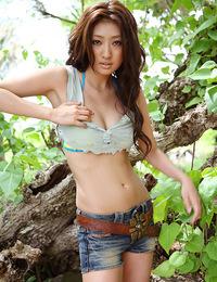 Incredibly beautiful gravure idol posing in her bikini at beach
