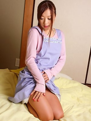 Miyu Hoshino Asian gets so horny while taking her clothes off