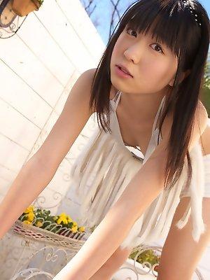 Hijiri Sachi Asian in shorts and bra enjoys sun on her curves
