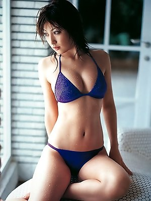 Stacked asian beauty shows off her big tits in a skimpy bikini