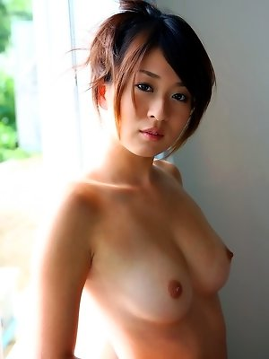 Asian model Rika takes off her dress and shows off her perfect ass and big tits