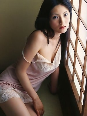 Sexy gravure idol entices in her provacative pink lace lingerie